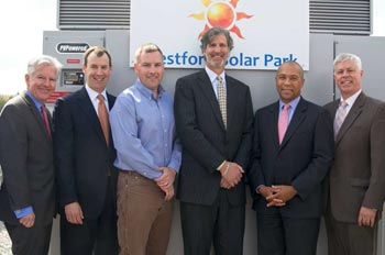From left, Chancellor Marty Meehan; Jeff Johnston, principal, Cathartes Private Investments; Will Thompson, senior vice president Nexamp; Jim Goldenberg, principal, Cathartes; Gov. Deval Patrick; and Richard Sullivan, Massachusetts Energy and Environmental Affairs Secretary, help launch the Westford Solar Park.