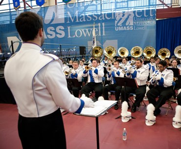 The Umass Lowell Marching band practicing, getting ready for an event.