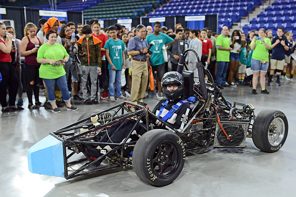 Mechanical engineering junior Spencer Culpepper drove a Formula SAE race car inside the Tsongas Center to the delight of the crowd at this year's Invitation to Innovation (i2i). Members of the River Hawk Racing club designed and built the race car, which is scheduled to compete this summer in Lincoln, Neb.