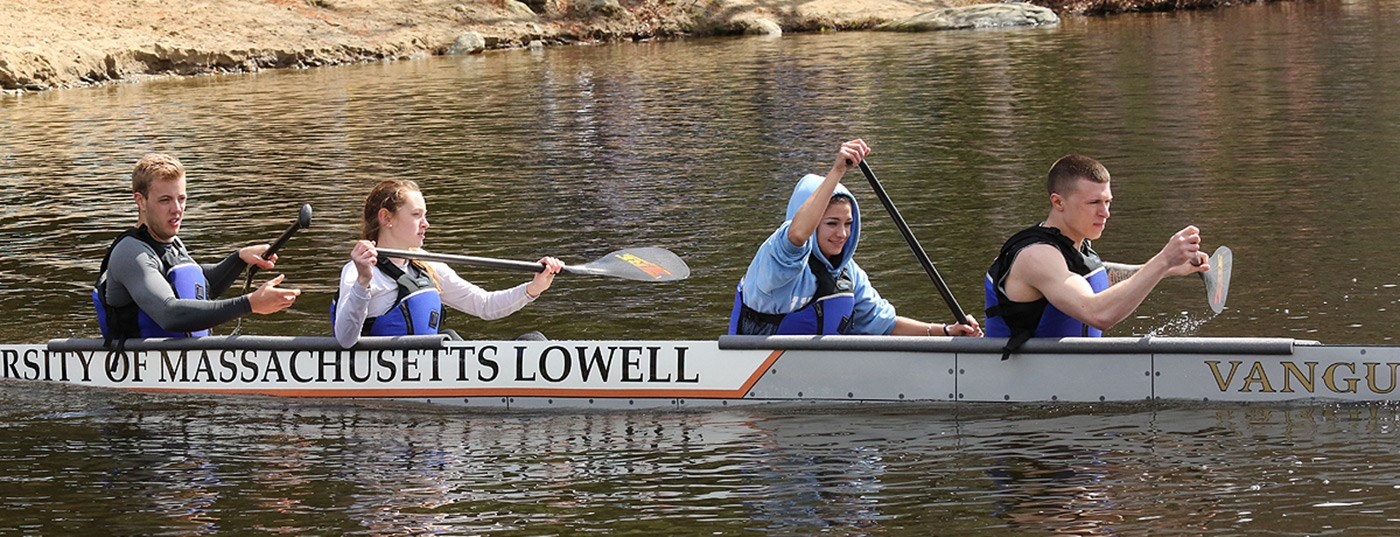 Timothy Roberts, Natalie Melconian, Rebecca Gonsalves-Lamontagne, and Zachary Morris paddle UMass Lowell's concrete canoe during the 2014 regional competition.