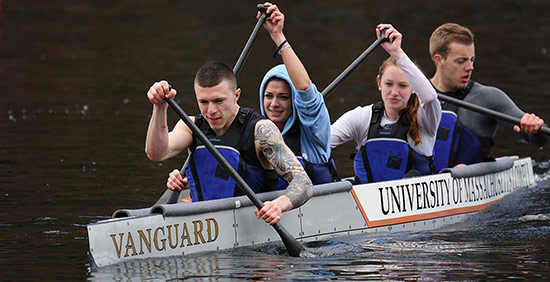 2-male-2-female-students-concrete-canoe-rowing-action-close-up-550-opt