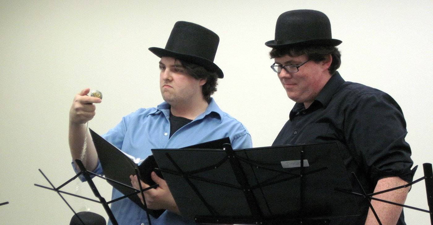 Two male UMass Lowell students dramatic reading of Charles Dickens.