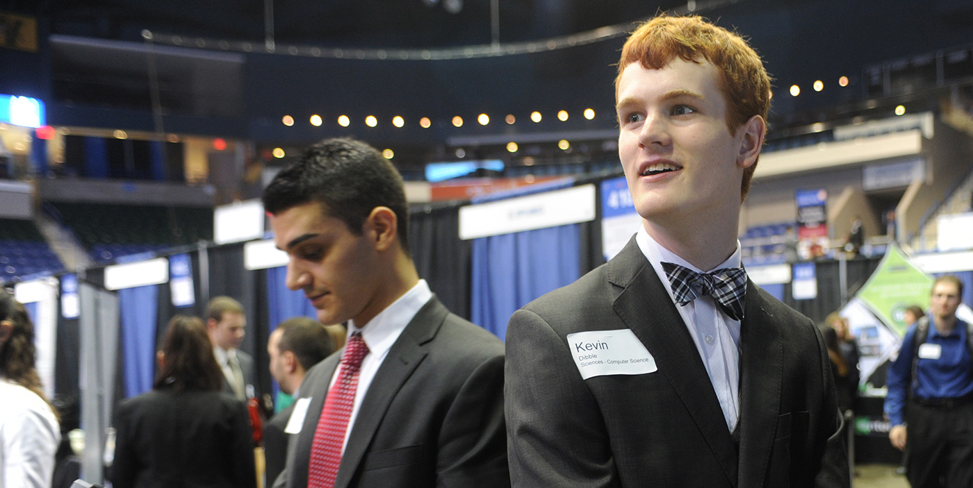 Two male students at the Career & Co-op Center's Career Fair at the Tsongas Center.