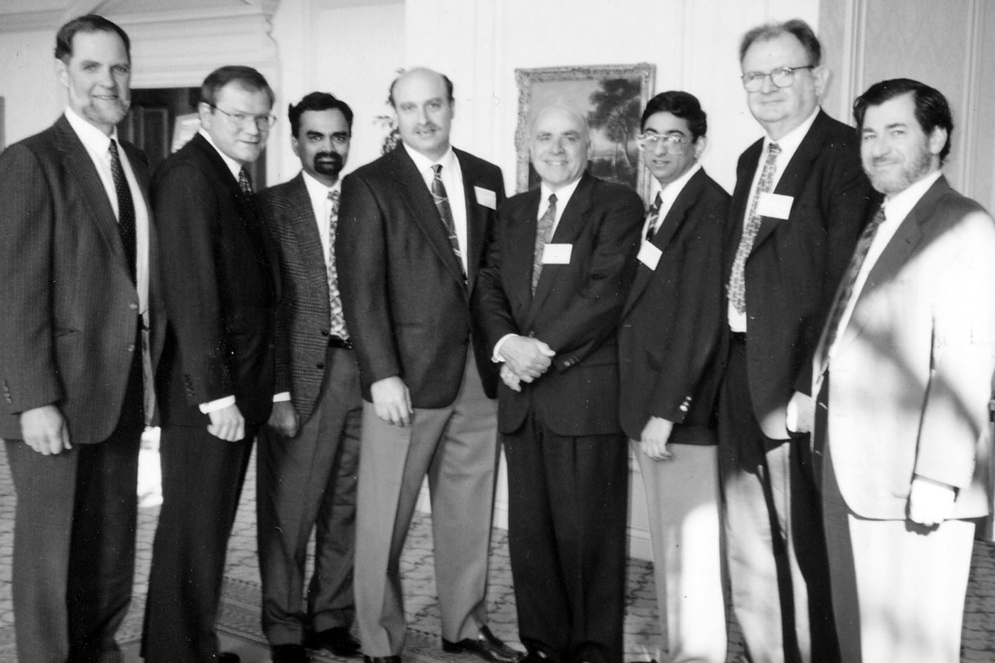 Dr. (Chancellor) Hogan, Husain Wetherell, Dr. Domas, Dr. Williamson, McGuirl, Provost Sukant Tripathy and Dr. Sharlin pose for a group photo. Sukant Tripathy, Professor at the University of Massachusetts Lowell, died on December 12, 2000 in a swimming accident in Hawaii after lecturing at a conference of the Polymer Chemistry Division of the American Chemical Society.