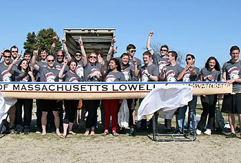UMass Lowell's 2013 concrete canoe team poses with 'Moswetuset.'