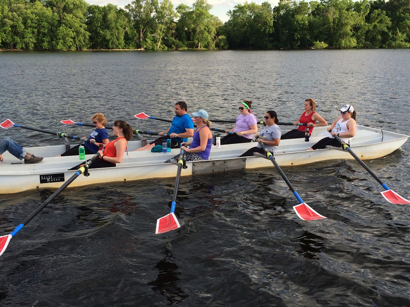 People learning to row on the Merrimack River.