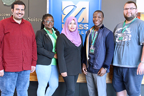This year's International Nuclear Institute (INI) fellows included, from left, Fares Altuwaijri from Saudi Arabia, Yvonne Sefakor-Dzovor from Ghana, Hasfazilah Hassan from Malaysia, Elly Omondi from Kenya and Maciej Lemiesz from Poland.
