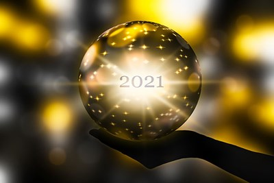 Hand holding 2021 crystal ball