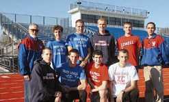 Umass Lowell's track team are gathered together, posing on Umass Lowell's Trackfield.