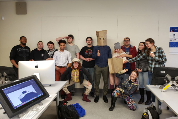 A whimsical shot of the Class of 2020 of UML's animation program. That's Pouya Afshar in the bag.