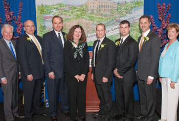 Shown at the awards event are, from left, Chancellor Marty Meehan '78; award recipients James Regan '88, Robert LeFort '83, Linda FitzPatrick '68, Richard Miner '86, '89, '97, Michael Jarvis '06 and Steven DiNoto '94, '97; and Executive Vice Chancellor Jacqueline Moloney '75, '92.