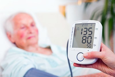 Patient with blood-pressure monitor