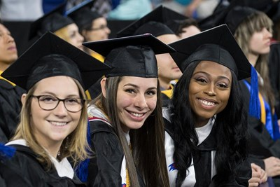 Three women at morning commencement ceremony