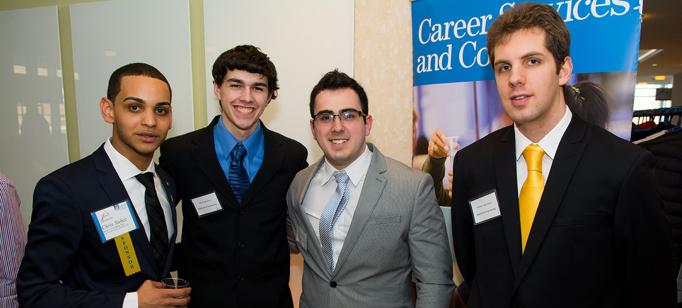Sponsor Chris Nunez, Alexander Moss (Mechanical Engineering), Plamen Atanassov(Mechanical Engineering), and a fourth colleague at the Career & Co-op Center's Dine & Dress for Success event.