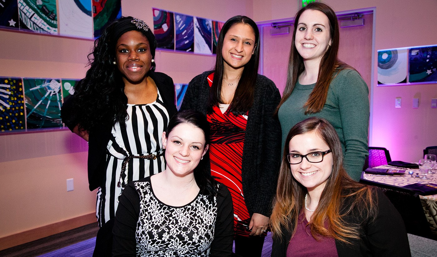 5 female students pose for a picture at the 2015 MLK awards dinner.