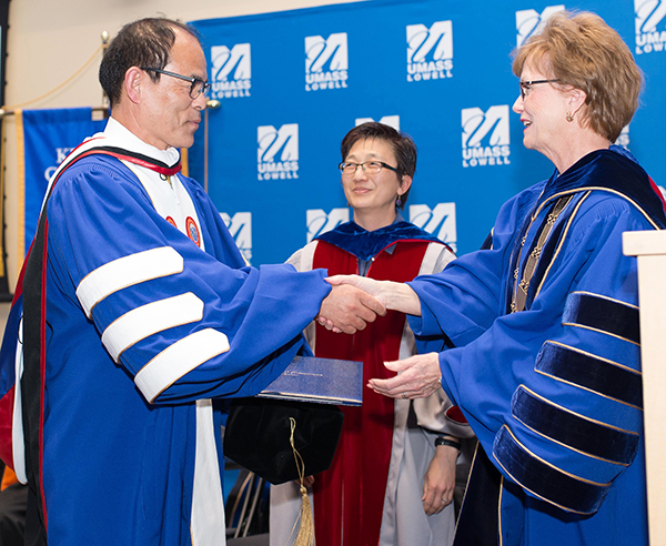 Nobel laureate Shuji Nakamura, left, was presented with UMass Lowell's highest honor, a doctorate of humane letters, on Wednesday, April 11 at a ceremony attended by more than 100 students, faculty and staff. Chancellor Jacquie Moloney, right, and Vice Chancellor of Research and Innovation Julie Chen, center, conferred the honorary degree. (Photo credit: Tory Wesnofske for UMass Lowell)