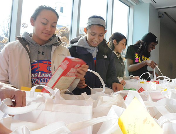 UMass Lowell volunteers will assemble Thanksgiving meal baskets for more than 300 families in need on Monday, Nov. 21.