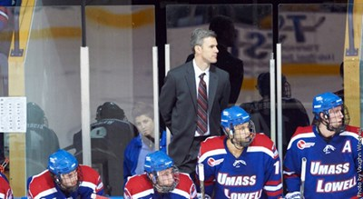 Men's ice hockey Head Coach Norm Bazin behind the bench