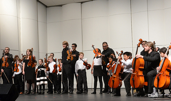 "Lowell schoolchildren enrolled in the UMass Lowell String Project will be among the performers during the ""Reaching Out!"" concert on Saturday, Nov. 19."