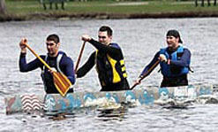 Students Jimmy Palantzas, left, Stephen Lahti, middle, and Brian Allard of UMass Lowell's Hydrohawk 2010 team race to the finish on the Charles River.