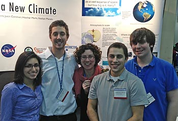 Assoc. Prof. Juliette Rooney-Varga, center, joins, from left, biology majors Heather Merhi, Justin Conchieri, Cameron Jenkins and Jared Nease at the recent AAAS meeting in Boston.