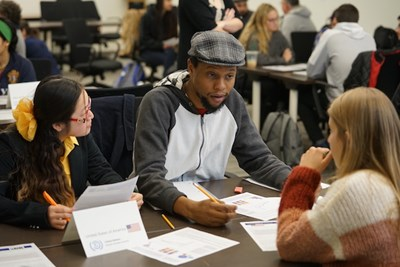 Student Javon Bryan takes part in the World Climate simulation with other students