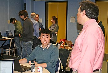 Computer science major Jonathan Yu explains his Blackjack Buddy project to Assoc. Prof. Fred Martin.