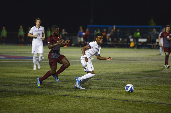 Abdi Hassan-Shariff playing soccer for the UMass Lowell River Hawks
