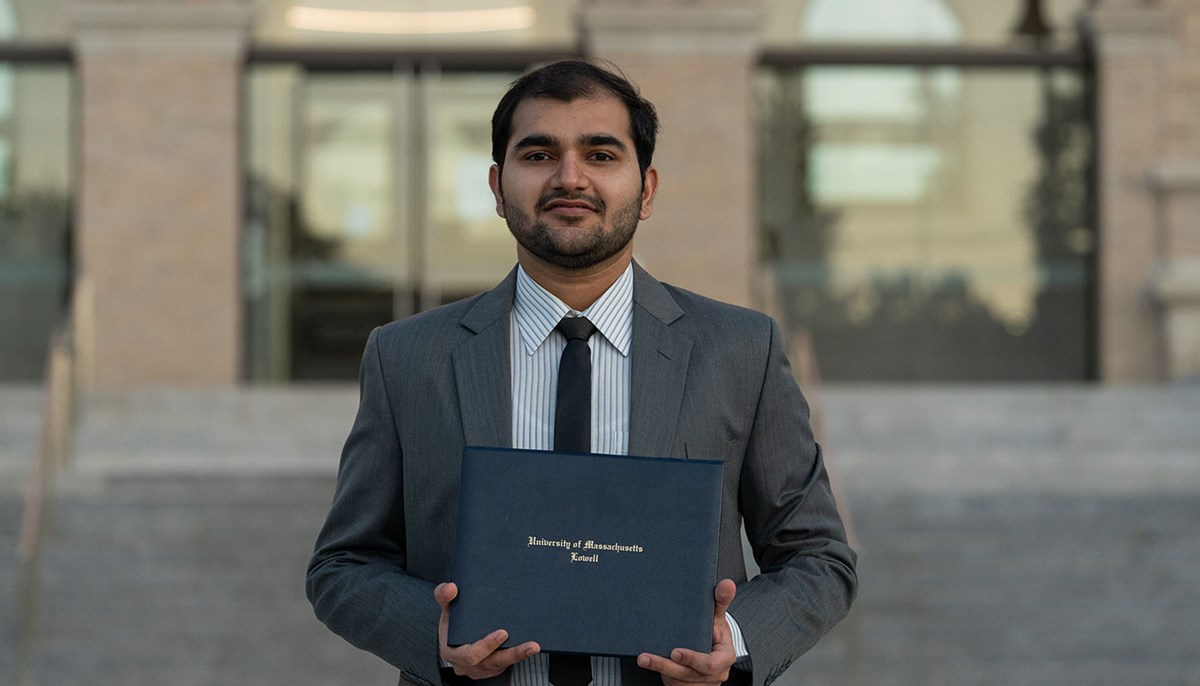 Abdul Hameed holds up his diploma