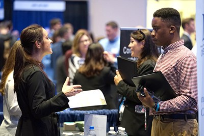 A student talks to a recruiter at the accounting career fair