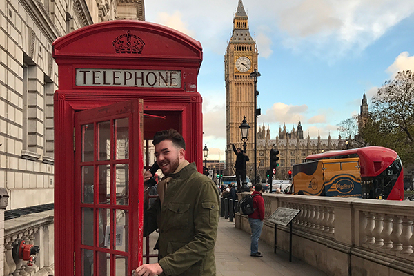 Honors student Matt Levenson checks out a phone booth on a trip to London.