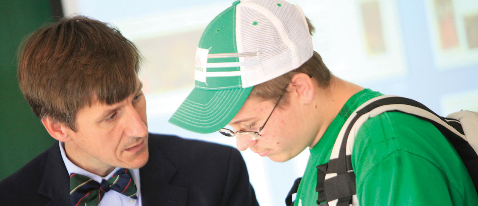 Professor Christopher Carlsmith talking to a student