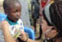 Alex Lamont of Lowell checks a child's heart in the village of Torkor.