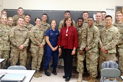 Liz Altman poses with cadets in her class at West Point