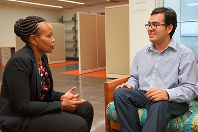UMass Lowell Asst. Prof. of Public Health Angela Wangari Walter with a graduate student