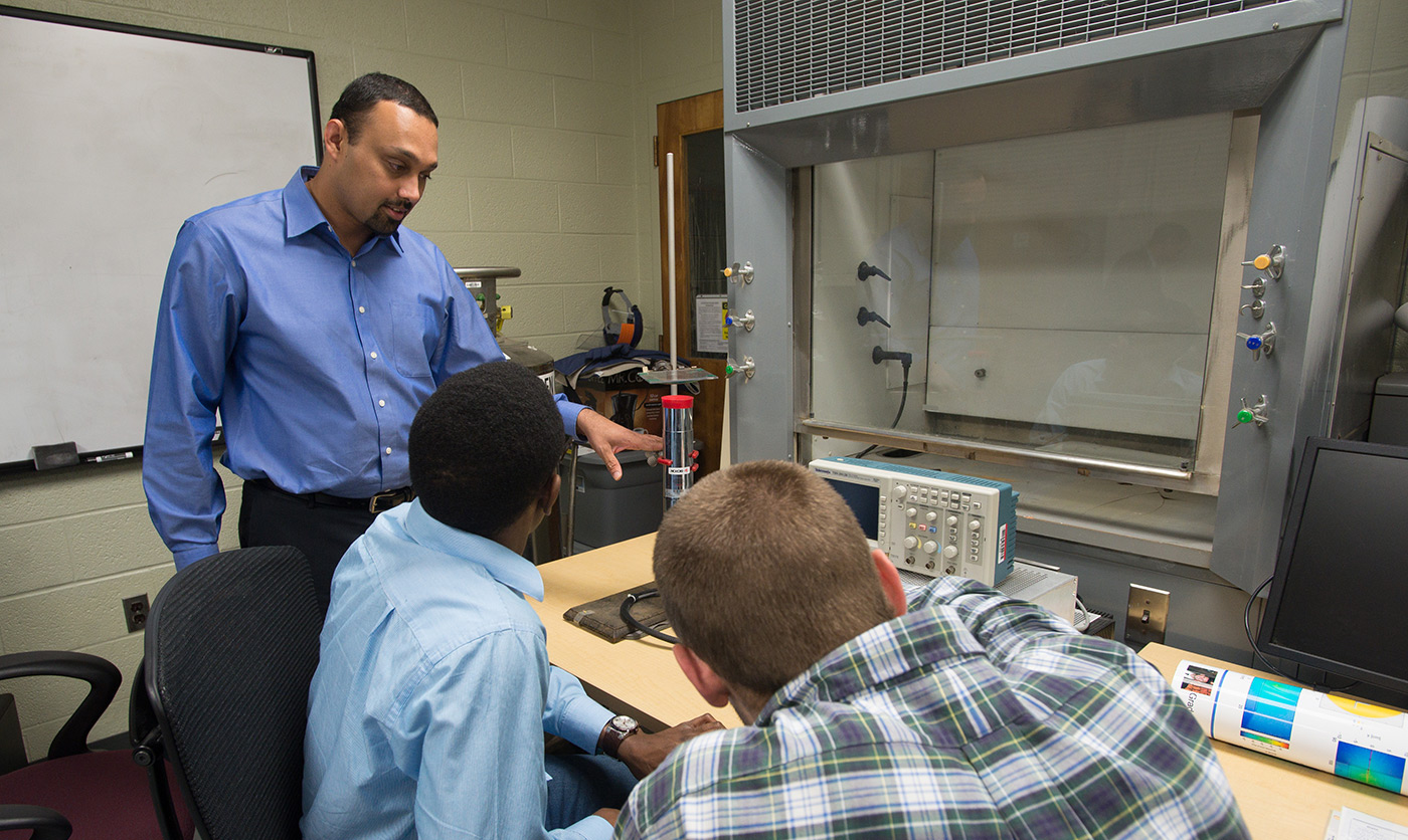 Associate Prof. Sukesh Aghara talking to two students somehwere inside the Nuclear Reactor.