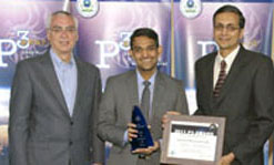 Graduate student Sethumadhavan Ravichandran, center, and Asst. Prof. Ramaswamy Nagarajan, right, pose with U.S. Environmental Protection Agency Deputy Administrator Bob Perciasepe during the EPA P3 award ceremony in Washington, D.C.