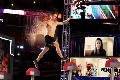 Barry Goers crosses steps during the American Ninja Warrior competition