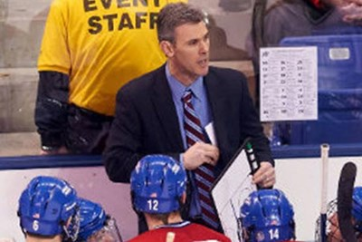 Norm Bazin coaching during a game.