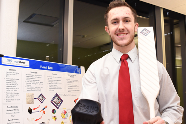 Sophomore Benjamin McEvoy shows off the plans for Benji Ball, which won consecutive competitions at the DifferenceMaker competitions.