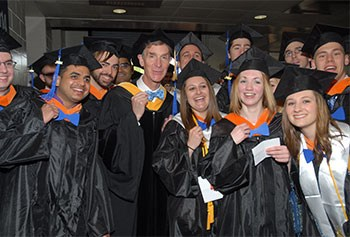 Bill Nye the Science Guy sports bowties with UMass Lowell graduates