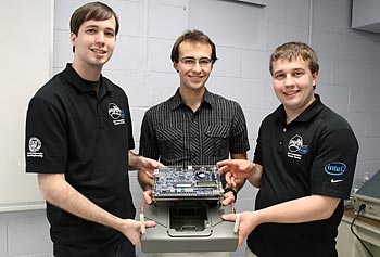 "From left, Andrew Gilstrap, Michael Antonov and Paul Paquette pose with ""Biobot,"" their prototype robotic bacteria and virus sensor."