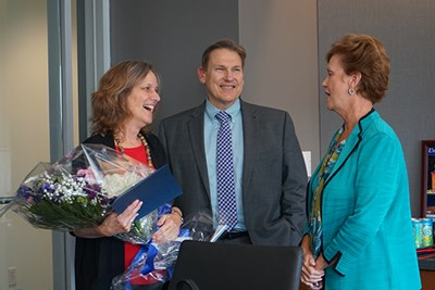 Meg Bond was named 2018 University Professor in a surprise ceremony at the chancellor's office. She was congratulated by Provost Michael Vayda and Chancellor Jacquie Moloney.