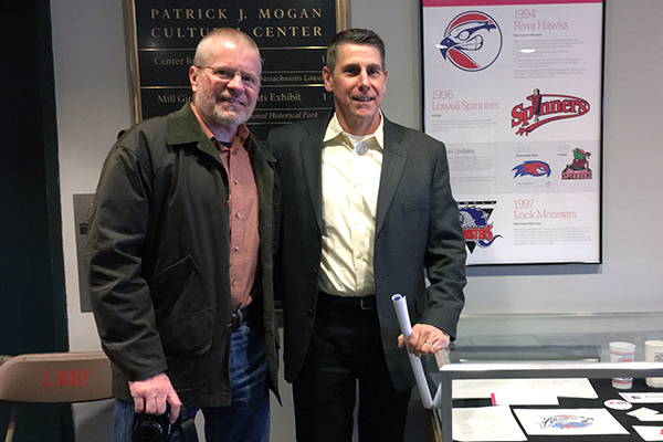 Brian Trainor (right) meets up with Bob Lucier, who helped him with the River Hawks logo. The two attended the opening of the Branding Lowell exhibit at the Morgan Center on March 24.