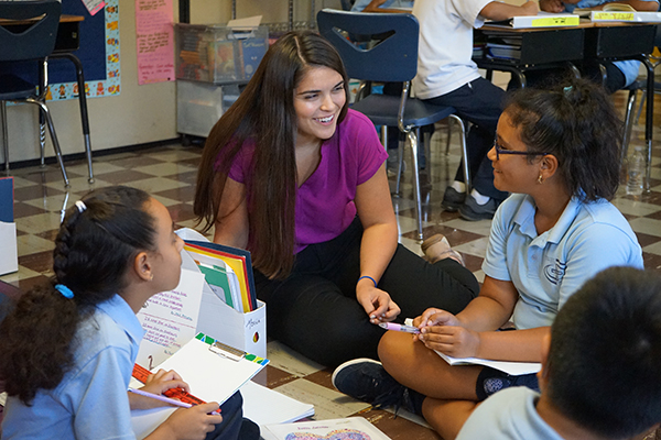 Honors student Brianna Atwood started a volunteer program at the St. Patrick School in Lowell.
