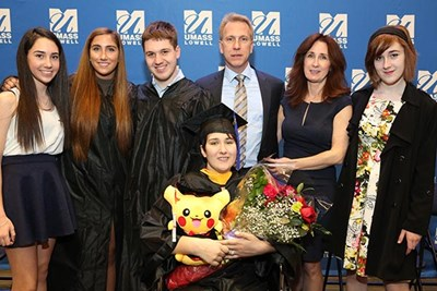 Brianna Gainley '16 at her March commencement ceremony, with family members.