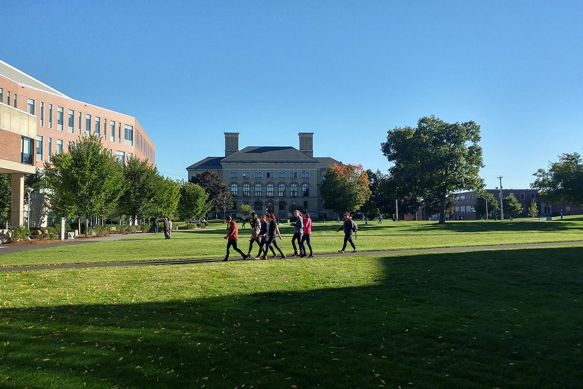 Students walk across south quad
