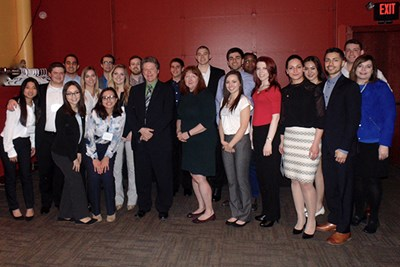 Manning students pose with alumni in Omaha, Neb.