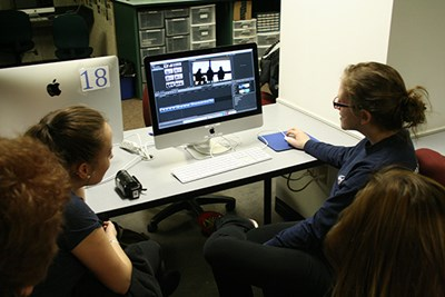 Students edit their Climate Change PSA at O'Leary