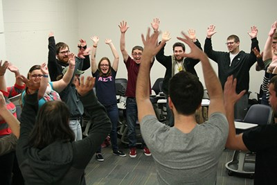 Students warm up with an improv exercise before making their pitches